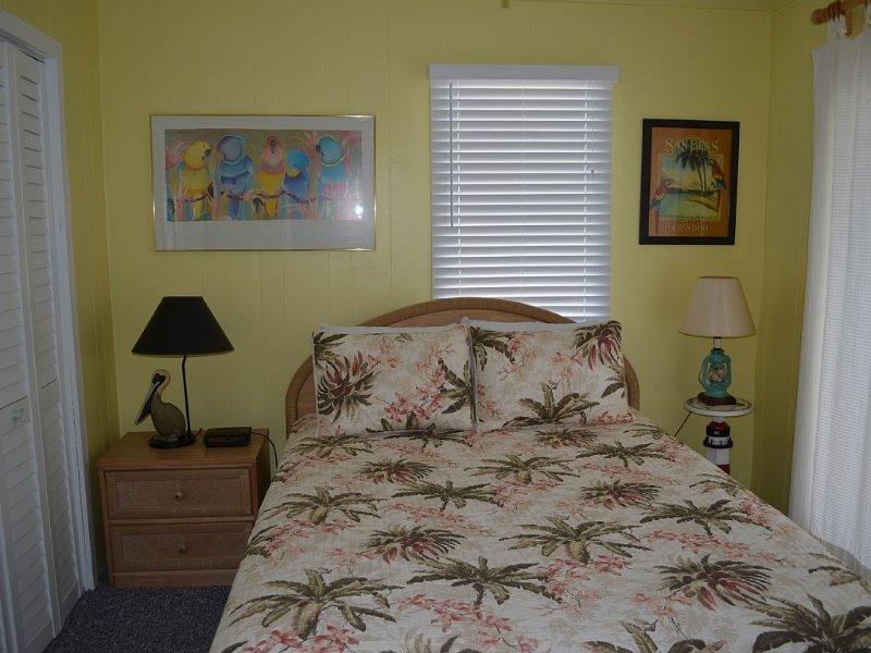 Downstairs Bedroom with queen bed and sliding door to oceanfront deck
