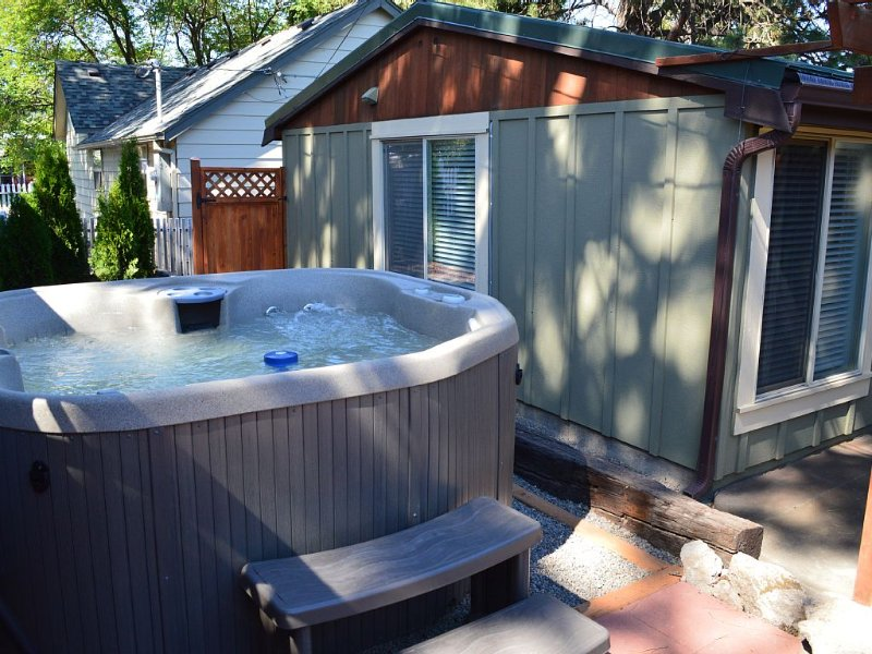 Private hot tub in the fully fenced backyard