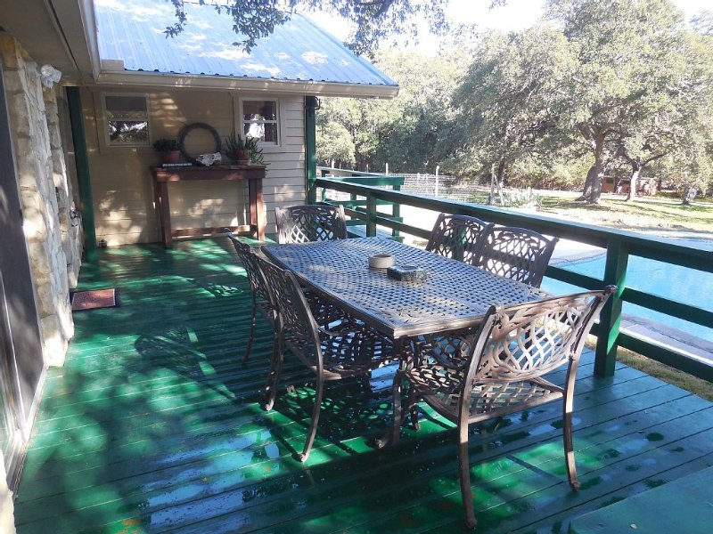 Outdoor deck w in ground pool and beautiful views off the back deck.