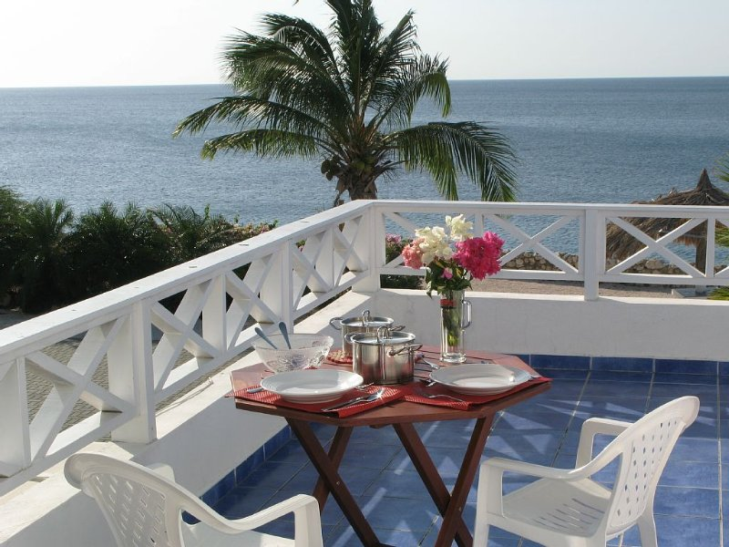 Enjoy breakfast or dinner at the balcony upstairs with stunning view on the sea.