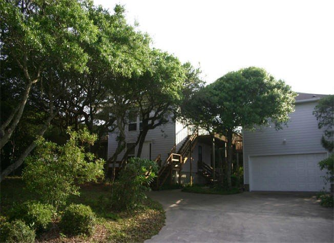 Nestled in the Oak trees overlooking the beach from our top deck. Great getaway