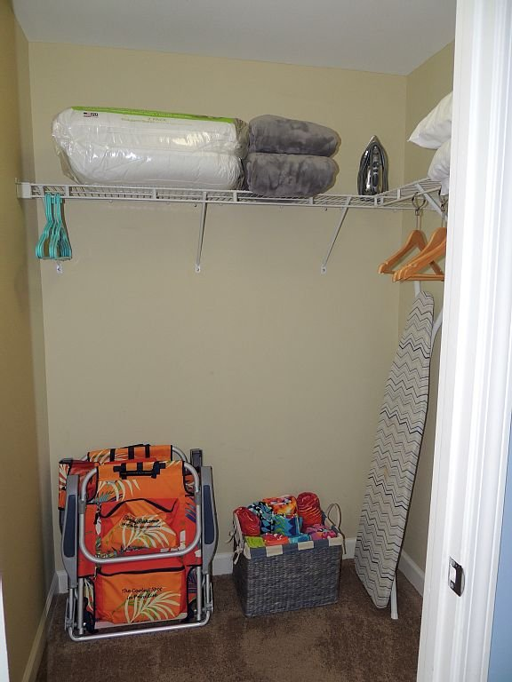 Master walk-in closet, beach towels, chairs, iron/board, extra pillows/blankets.