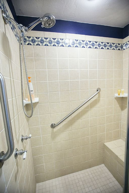 The large, walk-in shower has a built in bench for your comfort!