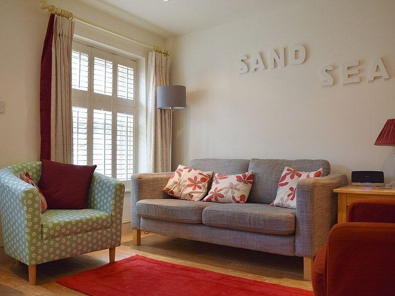 The cosy living room at Elgin Cottage