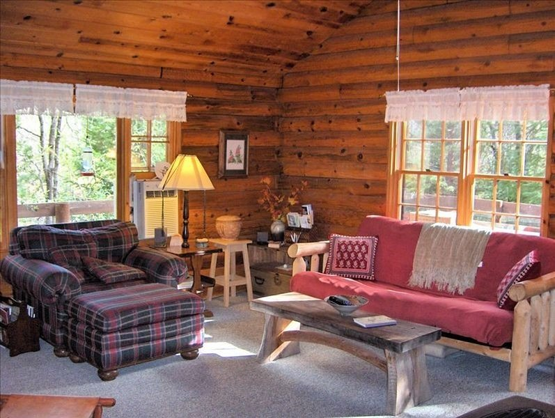 A comfortable, inviting livingroom with a hearth stove.
