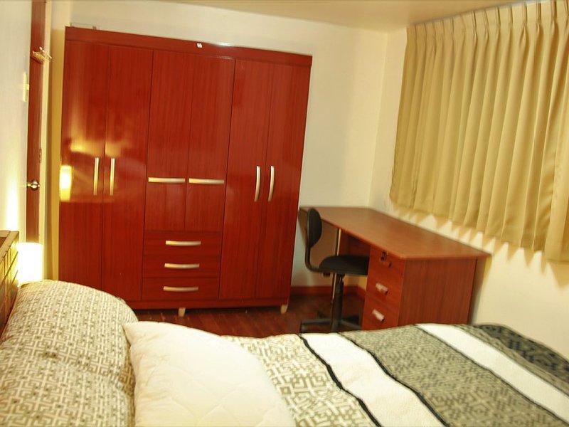 Bedroom 1 (desk & wardrobe)