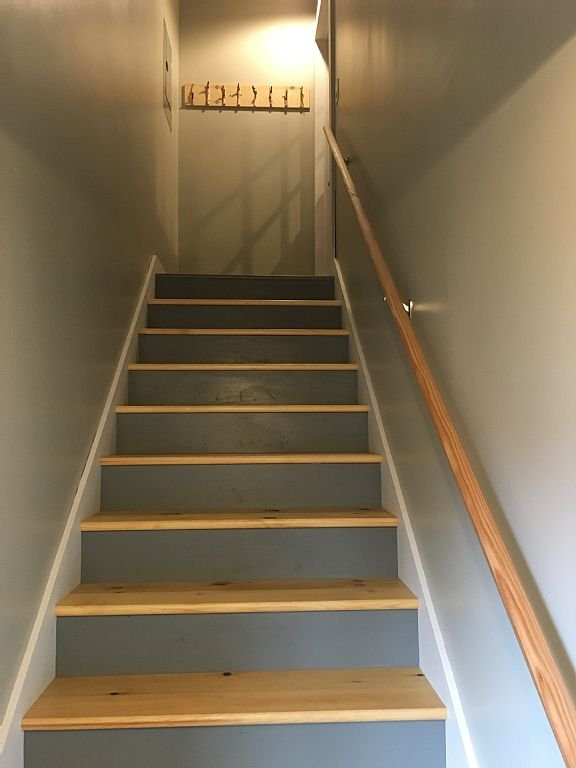 Stairwell to the second floor apartment.