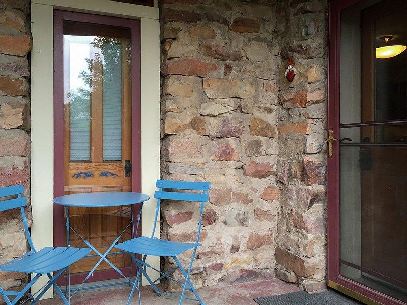 A few steps down and enter through the beautiful, original stone exterior