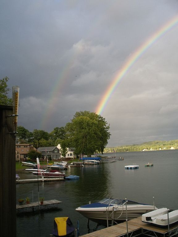 double rainbow viewed from the cottage's back door