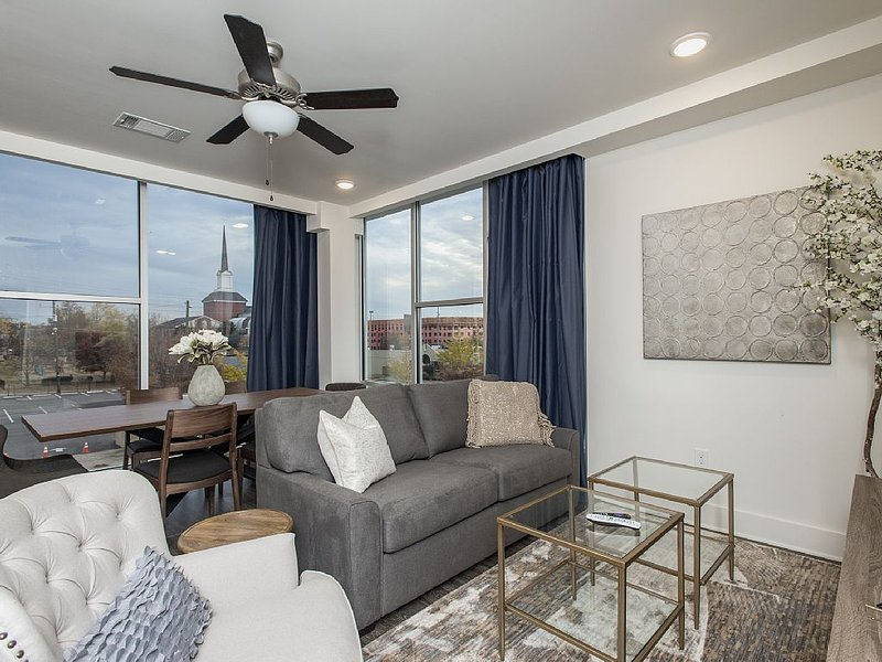 Queen sleeper sofa, flat screen TV, living space leads to outdoor balcony