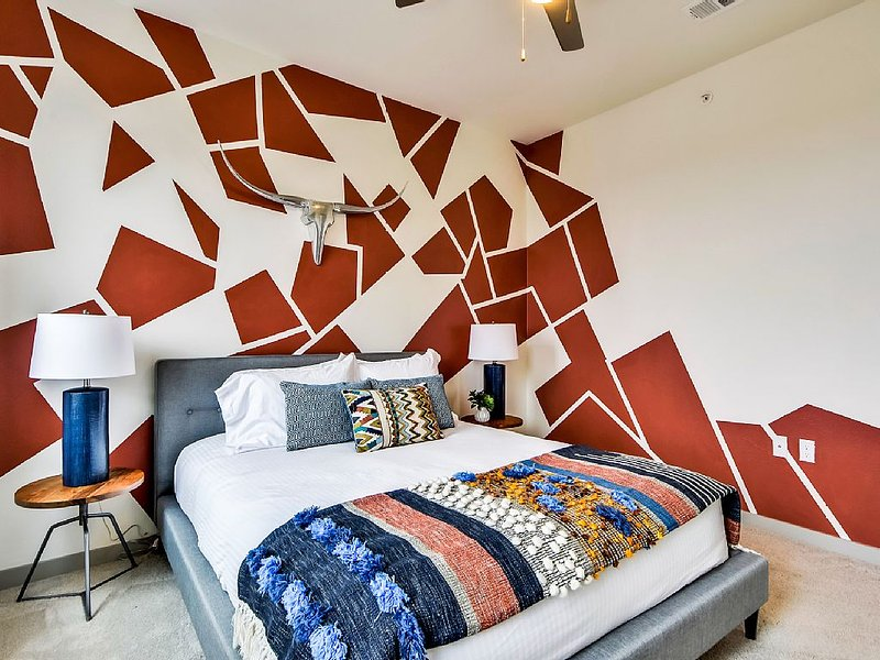 Guest bedroom with custom paint decor