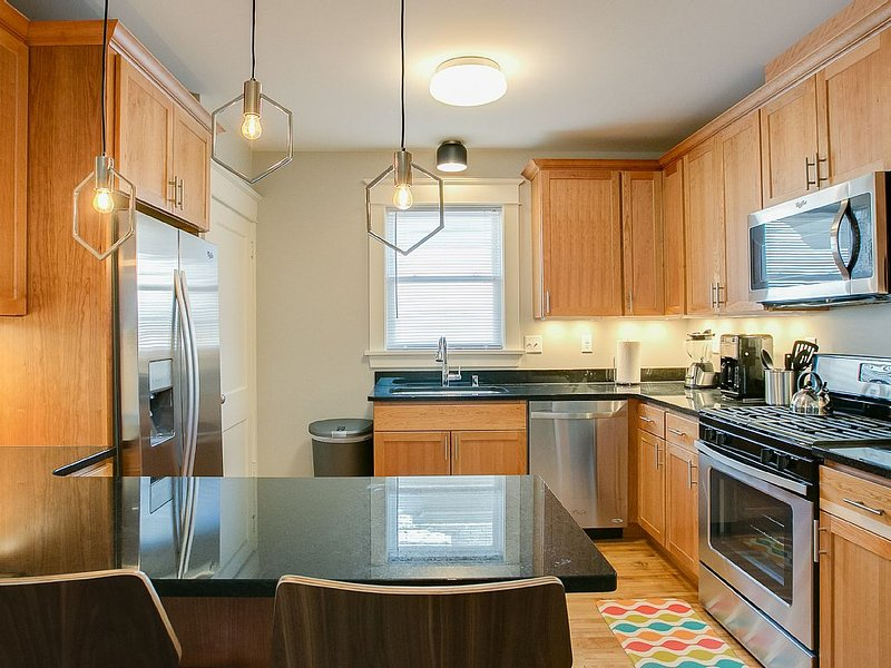 All new kitchen, with stainless steel appliances and granite countertops.