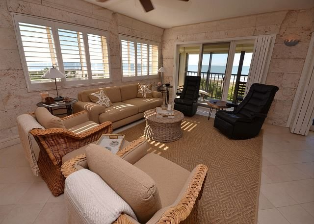 Beautiful living area with gulf front balcony access
