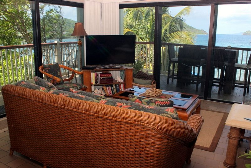 Waterfront, wrap around balcony. Lower $ available for longer stays. C8, vacation rental in Tutu