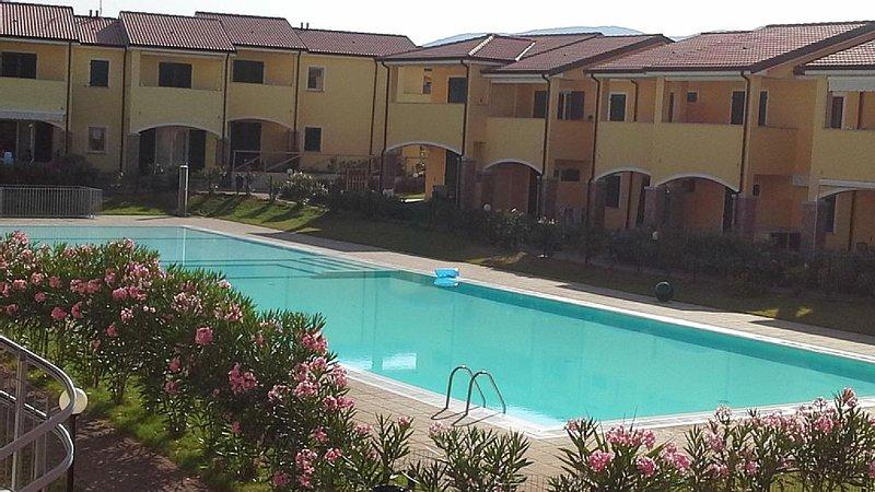 Casa sul mare tra dune e natura incontaminata a 50 metri dal mare con piscina, vacation rental in Badesi