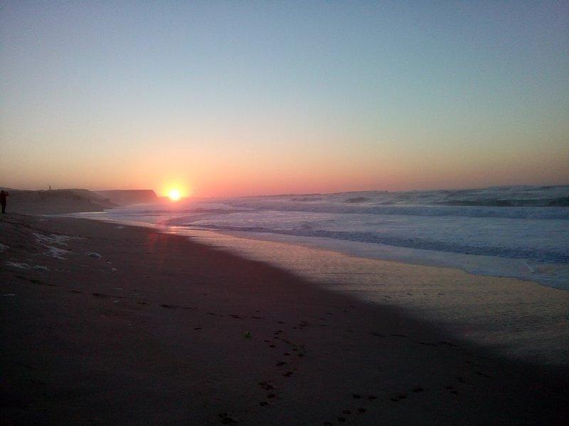 Sunset over Peniche fron Ferrel beach.