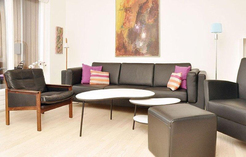 City Apartment in Kopenhagen mit 2 Schlafzimmern 4 Schlafplätzen, vacation rental in Copenhagen