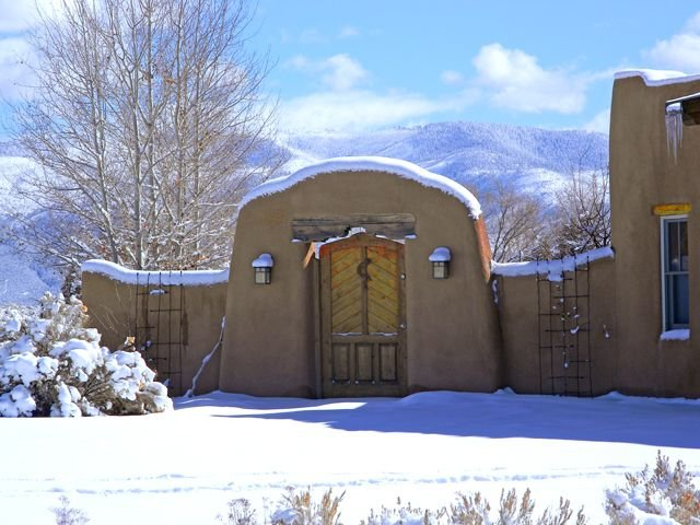 Custom adobe wall provides total privacy north, south, east and allows mountain views in all 3 directions