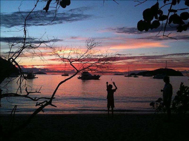 Our son at Maho Bay at sunset