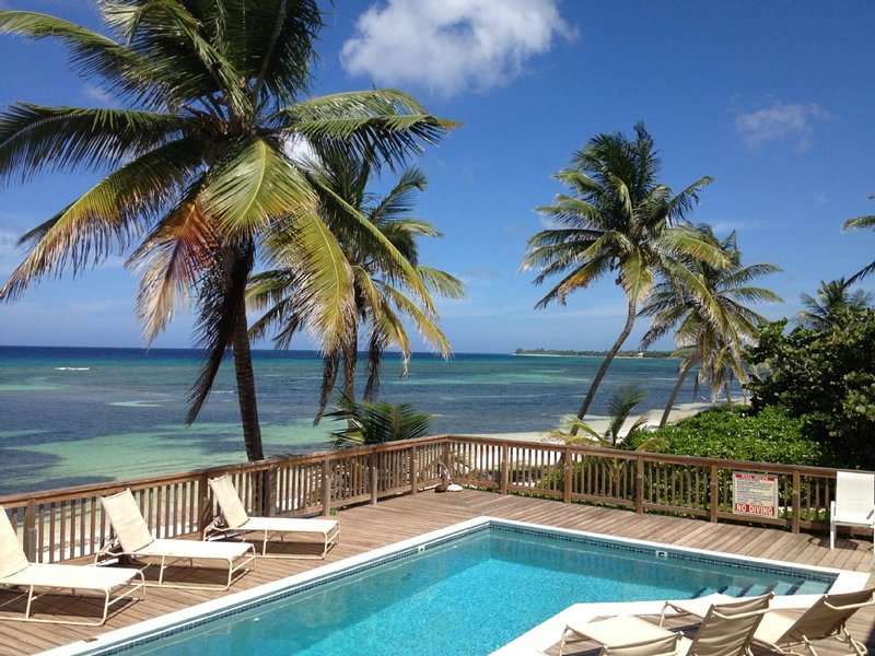 The Pink Beach House - Private House and Pool directly on the Beach, Rum Point, holiday rental in North Side
