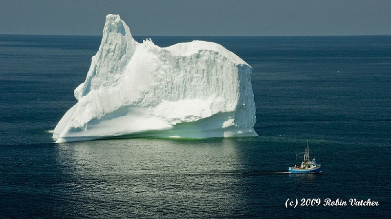 Photo I took in 2009 with a Longliner passing an iceberg