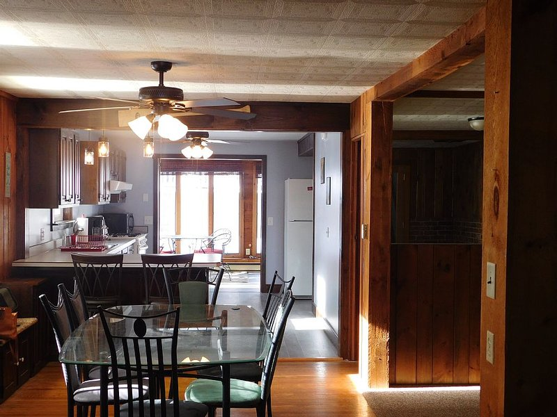 View from the living room through the dining room into the kitchen.