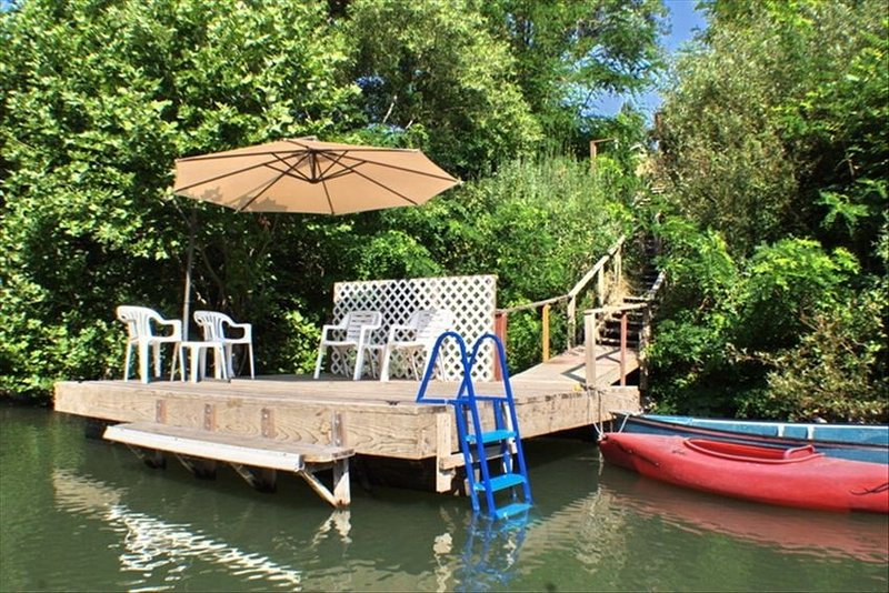 Deep water dock, steps from the house, for swimming and boating.