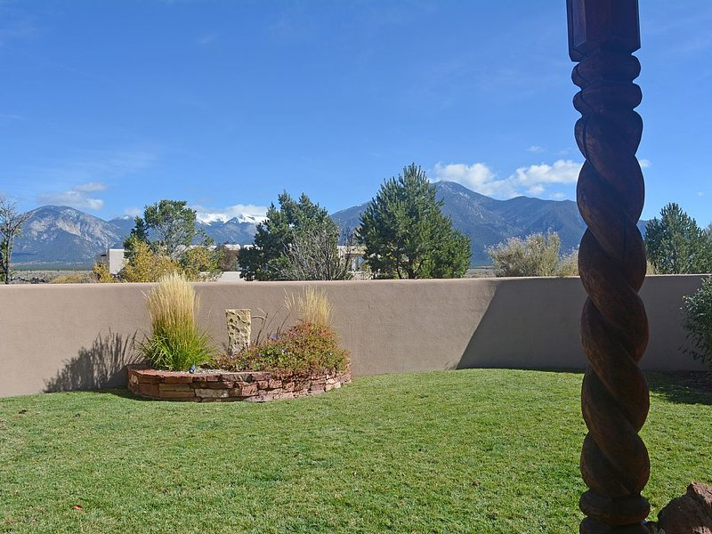 Adobe wall enclosed yard for seclusion and privacy all with mountain views