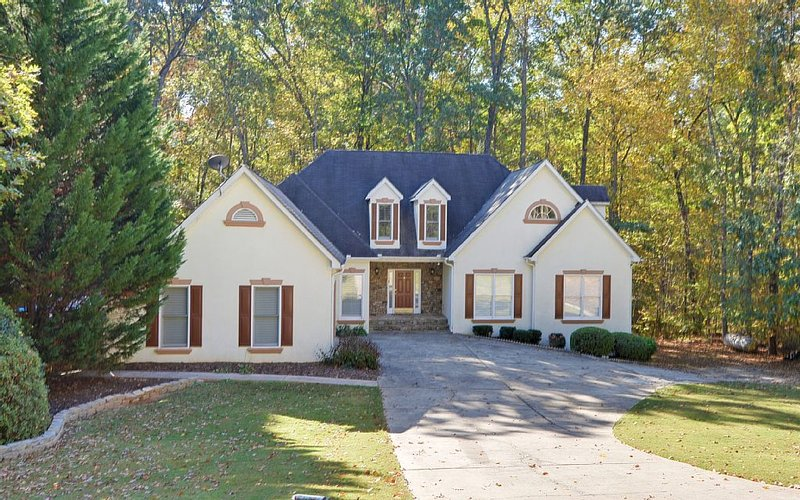 Located in a quiet neighborhood with a big yard and surrounded by lush woodland.