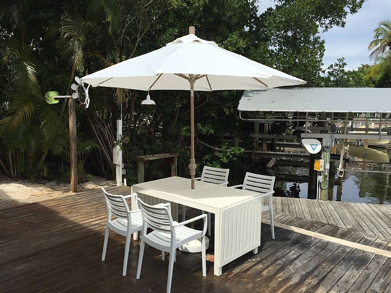 Newly renovated Old Florida house on Boca Grande w/ boat slips heated pool porch, holiday rental in Boca Grande