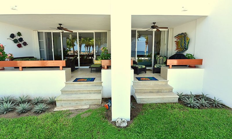 Private terrace off living room and beach front bedroom of 5120