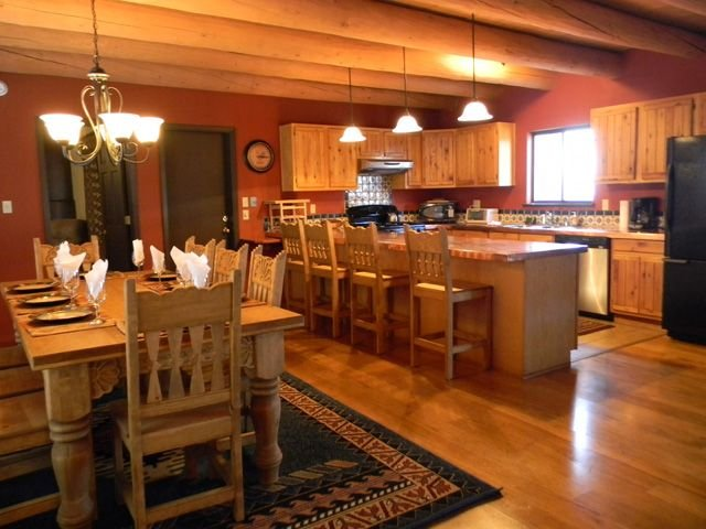 Large country kitchen, copper counters, large dining table + breakfast bar