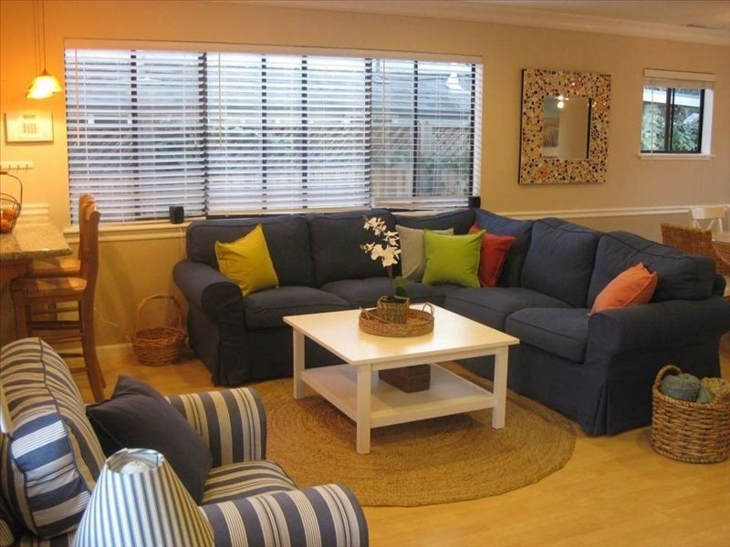 Relax in the bright, colorful living room with large sectional sofa