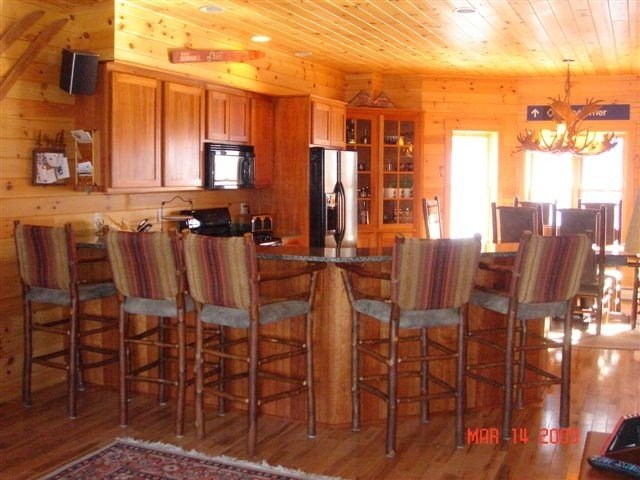 Spacious kitchen with large table and additional granite counter seating for 5