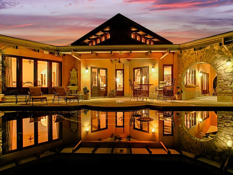 CASA ANTIGUA FROM THE INFINITY EDGE POOL AT NIGHT