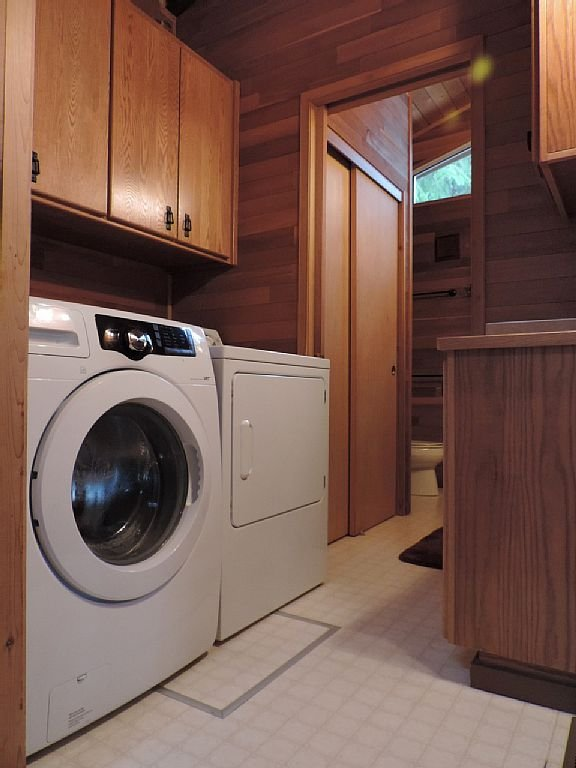 Full size washer and dryer, also ironing board, iron, all soaps.