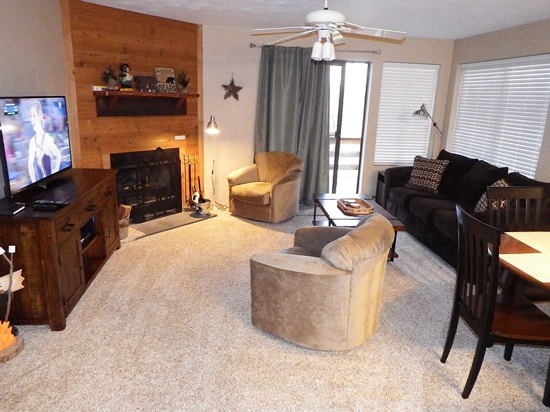 The living room is light and bright. Also features a 50' HD TV with Netflix.