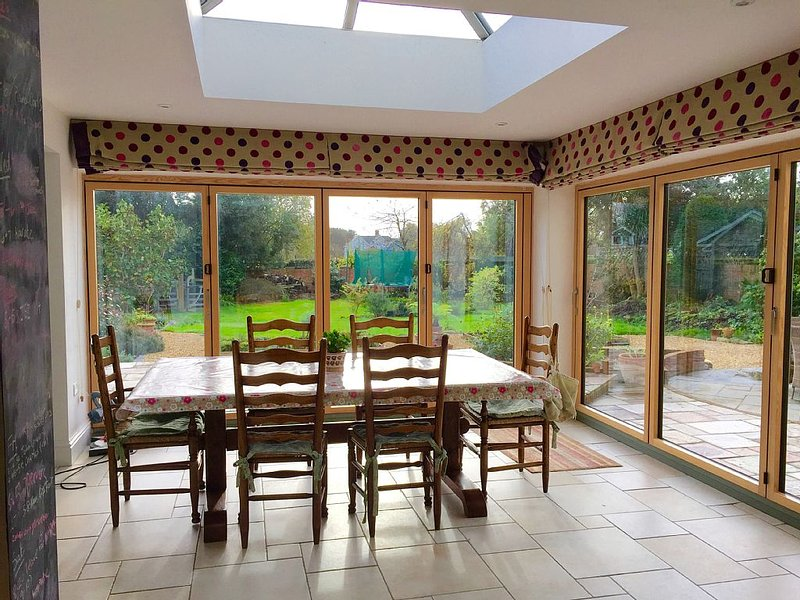 Dining area with bi-fold doors perfect for summer