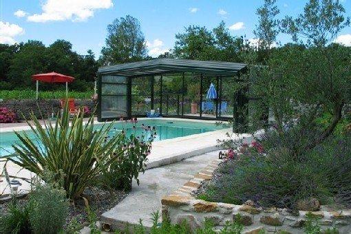 Entre Jurançon et Pyrénées ferme béarnaise avec piscine couverte et chauffée, aluguéis de temporada em Lahourcade