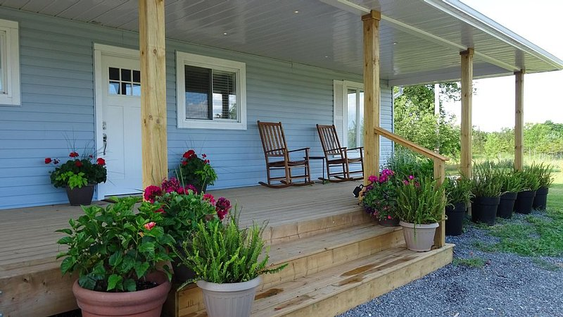 View from the front porch with rocking chair and seating area.