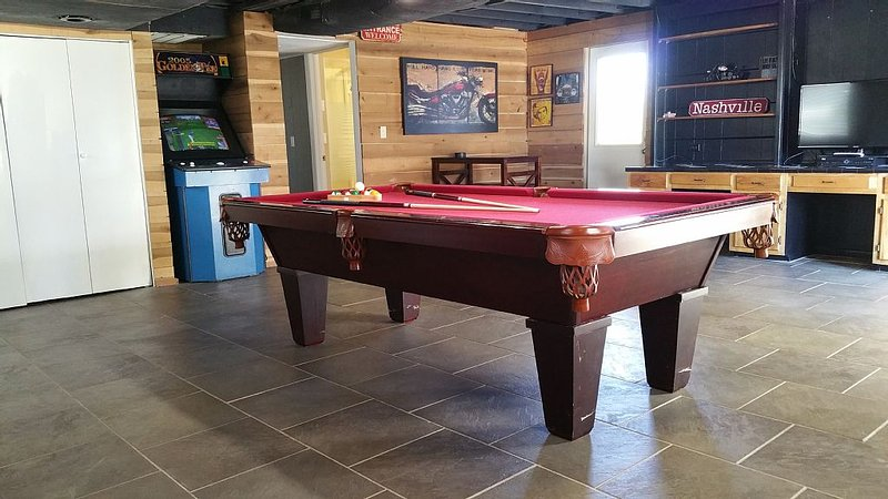 golden tee, billiards, and darts in game room