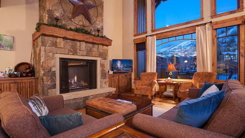 Living Room with view of the mountaind and gondola, love this room