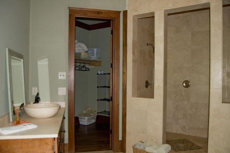 Master Bathroom with Tile Walk in Shower and Double Vanities.