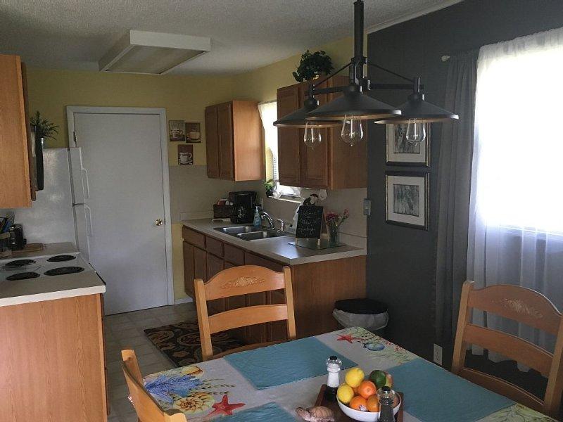 Kitchen/Laundry Room (door to washer/dryer)