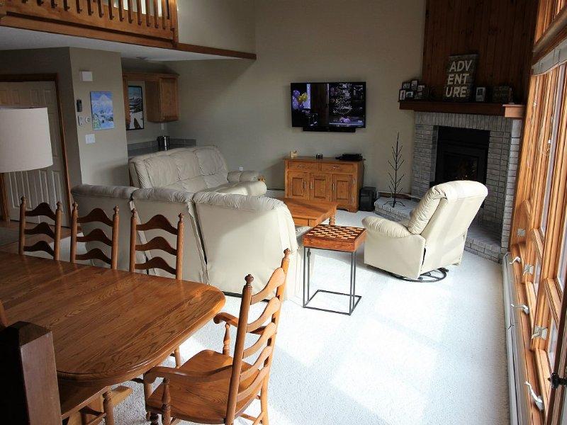 View of Main Level from Deck Door, bar area in back left corner