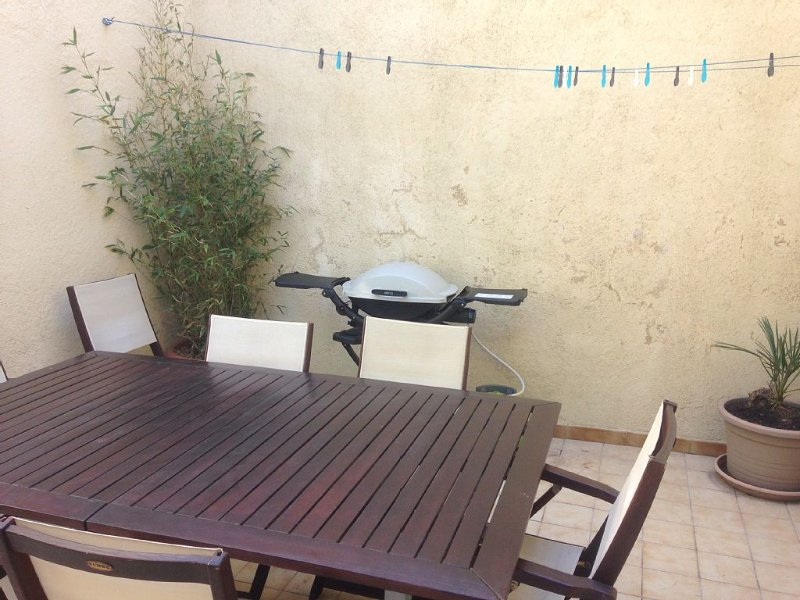 Terrace with a large table and Weber gas grill;)