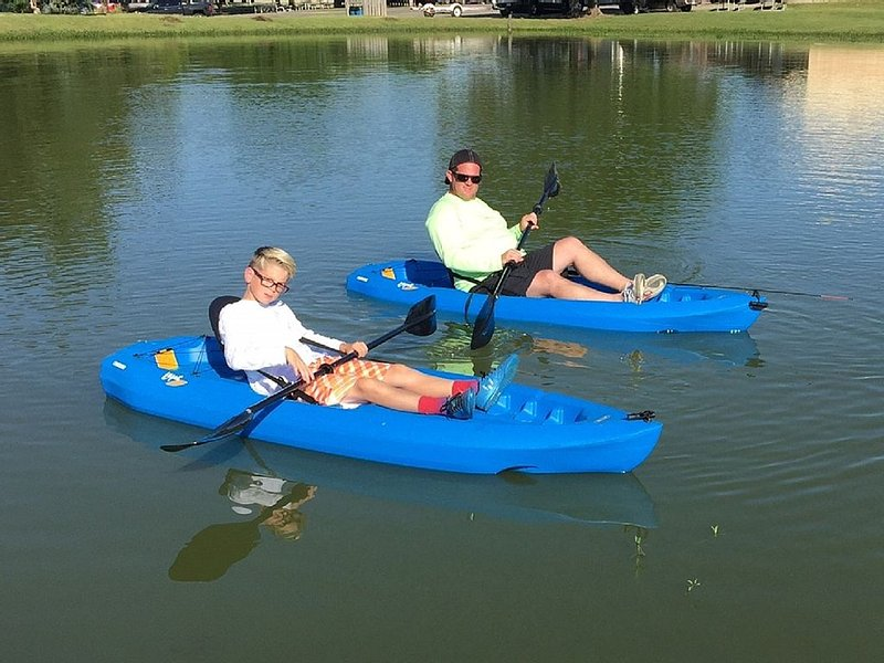 Relaxing in Sunrise Lodge pond in furnished Kayaks!