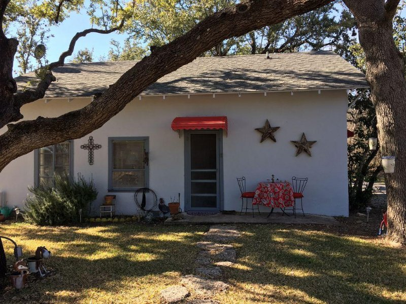 Spacious, vintage stucco cottage is unique and charming .