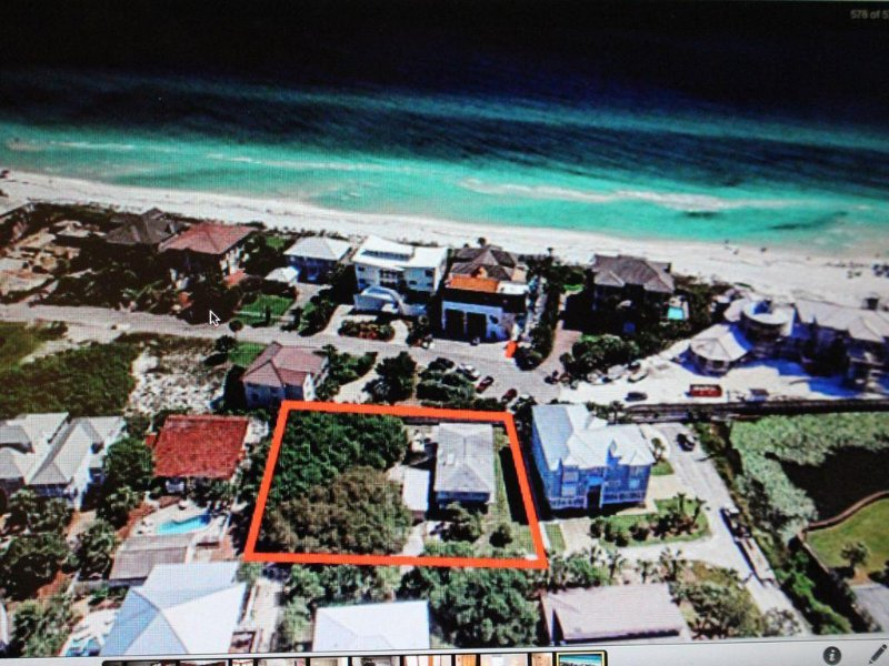 Property outlined in red. Beach walkover indicated by arrow.