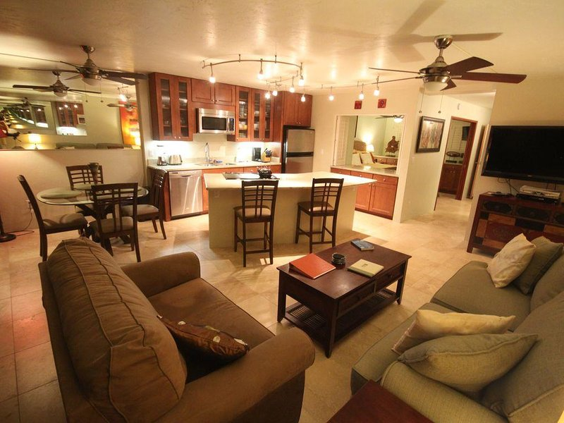 Relax in the remodeled kitchen/living room of Kuhio Shores 204
